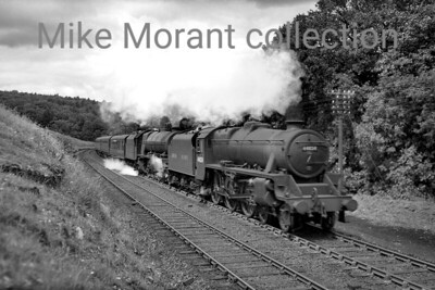 A stunning shot taken at Strickland of a classic double-headed combination with former LMSR Stanier 'Black 5' no 44834 piloting an unidentified Princess pacific.