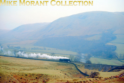 I can't understand why it is that I seem to be the only one who waxes lyrical over small steam in a big landscape. I've always loved this shot of a southbound Stanier 5MT scuttling southwards somewhere just south of Tebay in August 1964. I have no record of the exact location but Vic Smith has defined it as: Salterwath Bridge over the River Lune just south of Tebay. This view is still possible, but sadly only from a moving vehicle on the southbound M6.