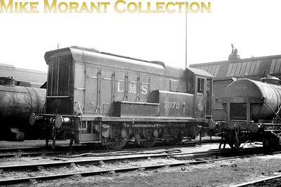 LMSR English Electric 0-6-0DE was a diesel shunting locomotive introduced in 1935  - photographed here at Crewe in 1937 -  and was one of eleven including the original demonstrator. Two survived to become BR class D3/6 but the remainder, including 7072, were requisitioned by the War department and sent for duty in Europe in 1940 with only one surviving the experience. Sadly, it wasn't this one. [Mike Morant collection]