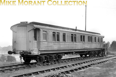 West Coast Joint Stock, LNWR sleeping carriage, at Lyme Regis on 28/6/53. This carriage provided overnight accommodation for loco crews on lodging turns. It was an LNWR design 65ft 6in sleeping car built in 1904 for West Coast Joint Stock, No. 325. The LMS renumbered it 10351, later 470. It was withdrawn from capital stock in 1941 and went into Departmental stock. In this picture it is DM198930 and the lettering in the centre says 'MOTIVE POWER DEPARTMENT LYME REGIS'. There were similar coaches at Wadebridge, Bude, Seaton and Launceston. [Mike Morant collection]