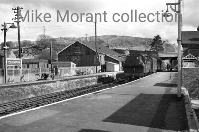 A wonderful panorama of Torrington staion viewed from platform level. The loco in the shot is Ivatt 'Mickey Mouse' 2MT 2-6-2T no. 41284 which was allocated to Exmouth Junction mpd at the time. [Mike Morant collection]