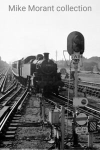 On 13/5/60 Ivatt 2MT no. 41284 enters Chalfont & Latimer's bay platform with the Chesham branch train comprising an Ashbury set of coaches.
