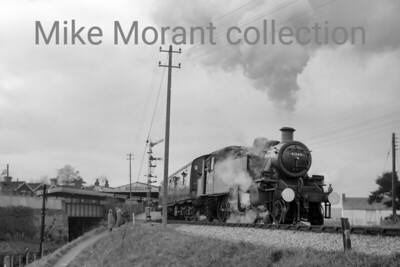 RCTS: Last Train on the Somerset & Dorset Line 6/3/66 Ivatt 'Mickey Mouse' 2MT 2-6-2T no. 41249 played only a small part in this tour hauling the stock from Templecombe station up to Templecombe No.2 Jct. But with powerful help at the rear in the form of Stanier 8F 2-8-0 no . 48706 and BR Standard 4MT 2-6-4T no. 80043. This was probably 41249's swansong as withdrawal came at Templecombe mpd in the same month.