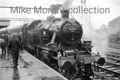 Manchester Rail Travel Society: Three Counties Special 26/11/66 LMSR Ivatt Mickey Mouse 2MT 2-6-2T no. 41204 at Stockport Edgeley prior to departure for Buxton. Indeed, Stockport Edgeley was also 41204's home shed when this shot was taken and  despite its apparently sparkling external condition withdrawal was only two months away in January 1967.