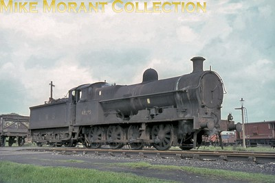 """LNWR Bowen Cooke G2a or 'Super D' 0-8-0 no. 48895 at Wolverhampton on May 11th, 1964. Note that the tender is still bearing the letters """"LMS"""" some fifteen years after nationalisation and Vic Smith informs me that this tender, no. 1136, was attached to 48895 on 19th January 1963 remaining with it for the rest of its working life. This veteran still had only seven months of service left before withdrawal as a Bescot engine in December 1964."""