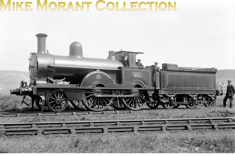LNWR Webb designed 'Precedent' class 2-4-0 no. 257 <i>Duke of Albany</i> circa 1913. There's no stated location but I suspect that a viewer will recognise the bleak backdrop.