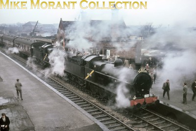 SLS: Farewell to LNWR Locomotives tour12/12/64 LNWR Bowen Cooke Super D 0-8-0's nos. 49430 and 49361 were the sole motive power for this round trip from Bescot to Bescot and most of the time were in double-headed mode as depicted here at Aldridge between Walsall and Water Orton West. I've noted from the actual timings of this trip that there was supposed to be an 11 minute stop here but due to late running it wes shortened to just 2 minutes. I have three shots taken by different photographers all taken from roughly this same viewpoint and one wonders whether they were iteinerent or very fleet footed!