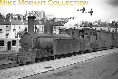 Taken in 1947/8, this delightful cameo features Webb Coal Tank no. 7794 at Newport (Mon.) station in charge of what is probably a workman's service to Tredegar. Of equal interest is the van which, from long ago memory, originated with the NLR (North London Railway) whilst  the small visible portion of the coach is an LNWR Brake Third. [Mike Morant collection]