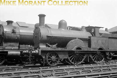 An undated view of LNWR Webb designed 'Jumbo' class2-4-0 no. 5032 The Queen in LMSR livery and photographed at Crewe Works. No. 5032 was built at Crewe and entered service as LNWR no. 1213 in April 1892. Withdrawal was in February 1932. Is it my imagination or is that a Robinson 2-8-0 in the background? A viewer has informed me that the LNWR did, indeed, purchase some of this class after WW1 but I have no further information here on that subject. Is it my imagination or is that a Robinson 2-8-0 in the background?