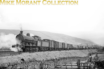 Bowen Cooke G2a class 0-8-0 no. 49282 in charge of a Down freight awaiting the assistance of a banking engine at Tebay. 49282 was far from home being Bescot allocated at the time. This shot was taken between July 1949 when the BR branding was applied and withdrawal in January 1951. Location notes by Steve Scott. [Mike Morant collection]