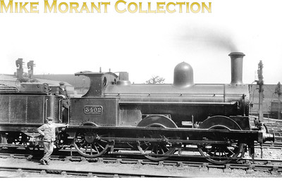 LNWR liveried Ramsbotton designed  'DX Goods' class 0-6-0 no. 3402 photographed in 1921 but with no indication of the location and I have no further data to hand regarding this engine's history.