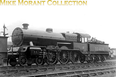 Former L&YR, Hughes designed 'Dreadnought' 4-6-0 LMSR no. 10416 at Agecroft shed in 1929. 10416 was built at Horwich and entered service as L&YR no. 1517 in October 1908 fitted with Joy valve gear but was rebuilt in 1920/21 with Walschaerts valve gear and larger cylinders. Although those rebuilds were considerably better performers and regarded as a success it didn't necessarily guarantee a long working life as 10416 was withdrawn in 1936. [Mike Morant collection]