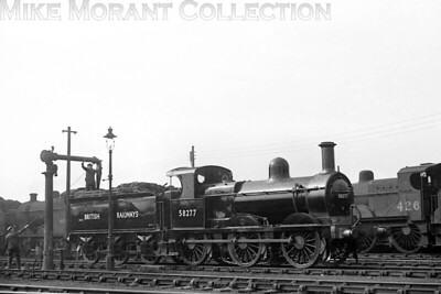 Former Midland Railway but a product of Neilso0n Reid, Johnson 2F 0-6-0 no. 58277 of 1897 vintage displays its newly applied early BR black livery at Derby on 12/6/49. 58277 was a Bescot engine at the time and was already 52 years old when this shot was taken. Withdrawal, also at Bescot, came in November 1955. [Mike Morant collection]