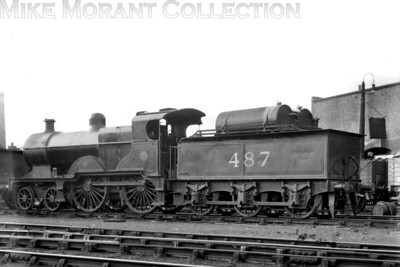 The LMSR experimented with oil firing during the general strike of 1926 and here we see Fowler/Johnson 2P class 4-4-0 no. 487 so fitted at Kentish Town depot on 15/7/1926. [Mike Morant collection]