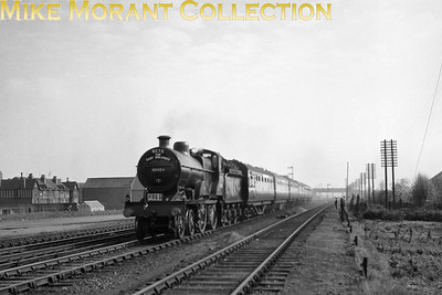 "RCTS East Midlander No. 2 Rail Tour 6/5/56 This tour used Johnson 2P 40454 solo for the first leg of the trip: Nottingham Midland - Castle Donnington - (via Camp Hill) - Bromsgrove - Worcester Shrub Hill - Norton Jn - Cheltenham Spa Lansdown and possibly for the last leg: Swindon Works - Oxford - Bletchley - Blisworth - Northampton Bridge Street - Wellingborough - Kettering - Nottingham Midland. But does anyone recognise this location?It seems that Tony Walmsley's efforts to nail this location down have borne fruit:  ""It looks like the approach to Beeston (Notts).  The clue is the half timbered building on the left.  Looking at Google Earth, I notice that a very similar shaped buidling exists today on Grace Avenue at its corner with Windsor Street.  It is now rendered, but the roof line looks almost the same and there are even simlar industrial buildings opposite.  That makes the bridge in the background the main entrance road into Boots.  The train would therefore be travelling South West, putting the sun in the South East which would fit with a morning start from Nottingham.  There were goods loops at this location and on the left would be part of Beeston goods yard.""Vic Smith adds: ""Have checked with a 1956 map which clearly shows Nos 10-17 Grace Avenue, allotments, track into yard, Windsor Works Iron Foundry, signal positions and bridge whilst the building to right is on Lilac Crescent. According to the map the train is passing milepost 123½. ""And from Syd Hancock: ""The comments which you already have are correct - I should know I worked in this area for 47 years and saw this view every working day. The train is approaching the station which is 50- 60 yards behind the photographer. The track in the foreground is the up goods loop which ended immediately behind the photographer. The bridge in the background is indeed that which gives access to the Boots factory site."""