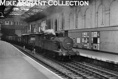 Fowler 3F 'Jinty' 0-6-0T no. 47554 in charge of a freight train passes through Farringdon station on the widened lines whilst on its way to the extensive marshalling yard at Cricklewood on 21/6/61. [Mike Morant collection]