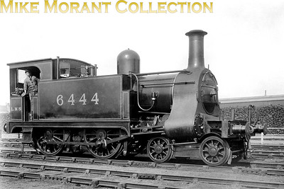 I think that this is quite a rare picture but my description probably won't do it justice. North London Railway William Adams designed suburban passenger 4-4-0T no. 6444, this is its LMSR number. Is depicted at or near the NLR's Devons Road works.More background for this image would be appreciated. [Mike Morant collection]