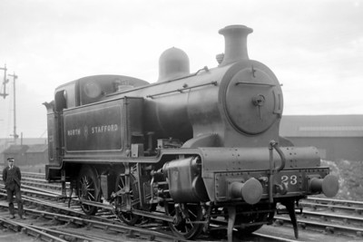 The unique North Staffordshire Railway 4-cylinder 'D' class 0-6-0T no. 23 was a product of the NSR's Stoke works in June 1922, was renumbered to 2367 and classified as 3P by the LMSR which saw fit to rebuild it as an 0-6-0 tender engine in 1928. Although the location isn't stated I suspect that we are looking at Stoke on Trent. [Mke Morant collection]