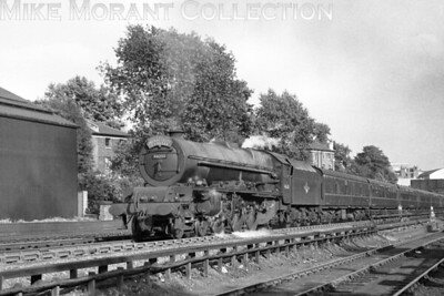 LMSR Stanier 'Princess' class pacific no. 46203 Princess Margaret Rose forges up Camden bank whilst in charge of the Merseyside Express and passes the engine shed in July 1959. Thankfully, 46203 is still with us today in the heritage era.