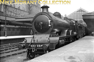One of the graceful Great Central Railway atlantics, in this instance Robinson Jersey Lily C4 class no. 194, depicted here in GCR livery at Nottingham Victoria station. Note the six wheeled carriage in the left background. It isn't sharply focussed but the one visible letter seems to be an 'N' suggesting GNR origin. Chris Knowles-Thomas to my rescue with historical background:C4 class, GCR No 194, so presumably photographed early in LNER days.  Its first LNER No. would be 5194 and it was numbered thus Oct. 1925.  It became 2901 under the 1946 renumbering scheme and was withdrawn in Nov 1950 without getting its allocated BR number 62901.  Yes, ex-GNR stock in the background.  It was a joint GCR/GNR station by the way.And a little more from Tony Walmsley: Victoria station was served by GNR trains from Grantham and Derby amongst other places most of which left to the south and ran via London Road High Level station.