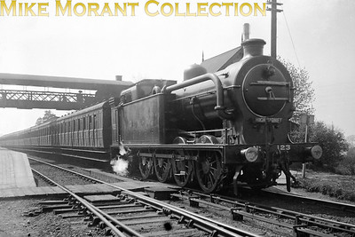 Beware information supplied by sellers of negatives! This shot which I think is quite a scarce one is dated 1925 which is an impossibility as the entire class had been moved to the West Riding of Yorkshire some decades previously. However, let's not allow that to detract from this fine shot of  GNR Ivatt R1 class 0-8-2T No. 123 in immaculate condition photographed at (allegedly) Woodside Park station whilst on a New Barnet service. Date? more likely to be 1905 than 1925. The only other data I have is that 123 as LNER 3123 was withdrawn from service at Colwick shed in 1928.