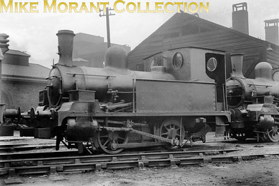 This charming little loco is an H&B Rly Class 'K' 0-4-0 well tank, which was one of a small class of 6 engines built by Kitson & Co in Leeds between 1886 and 1889. These were numbered 43 thru' 48 and were used in the H&B Rly docks area in Hull particularly for shunting 4-wheel bogies for carrying limber to the stock yards - note the additional heavy timber buffing blocks on the buffer beams for that purpose. The building behind is the rickety timber engine shed located on Alexandra Dock, which was eventually demolished by the LNER due to its poor, unstable condition. Recommend reading is the book by M. A. Barker, titled 'An Illustrated History of Hull and Barnsley Railway Locomotives published by Challenger Publications and from which these loco details are drawn. [Mike Morant collection]