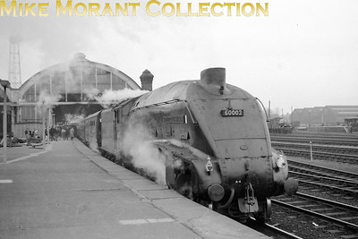 Gresley A4 pacific no. 60002 Sir Murrough Wilson in charge of a morning cross- country service to the south west at Darlington. Dave Whitaker informs us that the date of this shot is early 1963. The cabin on the platform was there in connection with the building of the B R microwave telephone exchange in 1962-63 the mast of which can be seen in the picture. [Mike Morant collection]