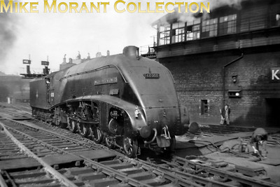 LNER Gresley A4 pacific No. 60008 Dwight D. Eisenhower backs out of King;s Cross station in the summer of 1956. 60008 had entered service in September 1937 as No. 4496 and called Golden Shuttle but was renamed in 1947 to commemorate the achievements of the Allied Commander-in-Chief during the second world war. This loco spent almost all of its working life allocated to either Grantham or King's Cross depots and was withdrawn from service at New England in 1963 but the story doesn't end there as it was donated to America's National Railway Museum at Green Bay. At the time of writing (21/8/12) 60008 is being returned to the UK for a loan period of two years as I understand it.