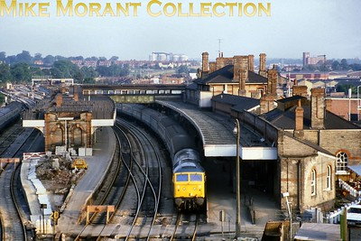 An unusual view of Ipswich station taken from above the tunnel mouth. This shot, depicting a Class 47 in charge of a Norwich -Liverpool Street service, was taken before electrification and by the looks of it during the immediate aftermath of the demolition of the signal cabin at the London end of the island platform suggesting that the shot could be dated quite closely to that event. The slide has '84' written on it in pencil and it's been confirmed that the signal cabin closed in April '84. Perhaps of interest to viewers is that I lived only about 300 metres directly behind this vantage point in the mid-1990's but one had to walk around the hill to get there which at least doubled the distance. There's a little known fact another 200 metres in that same direction which manifests itself as Station Street and crosses over the tunnel mouth at the London end. Very strange even for residents as it's at least a half mile from a station but it's a reminder that it served the terminus of the Eastern Union Railway until the tunnel was bored and the present station replaced it. A turning off Station St. is the very short Webb St. whiuch has the EUR Hotel at the further end. Very nice it looks, too. When I lived there it was a not very pleasant watering hole which had a splendid inn sign depicting a green liveried 4-2-2. The opposite corner, now residential, was also a pub called the GER but that referred to the Brunel steamship and not the railway with that title. It was closed in 1996 on health grounds and thank heavens for that. [Mike Morant collection]