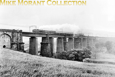 An unidentied Gresley K3 2-6-0 in tender first mode crosses Dinting viaduct in June 1954. The other shots in this series suggest that it was taken just prior to the start of electric services via Woodhead. [Mike Morant collection]