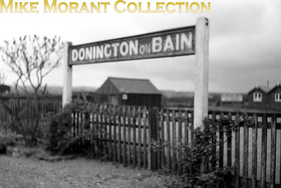 Running-in board at Donimgton-on-Bain station taken on 16/5/54. The station had closed on 5/11/51. [Mike Morant collection]