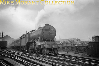 Stormy skies dominate LNER Gresley K3 class mogul no. 207 during its departure from Sheffield Victoria in 1934. No. 207 would become BR no. 61864 in May 1949 whilst allocated to New Ejngland and would see out its service at the same shed in September 1962.