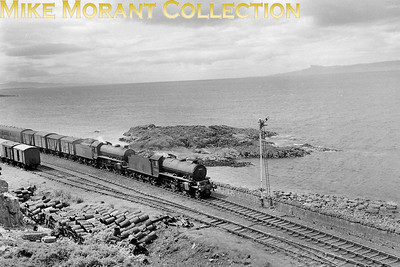 The 5.45 a.m. Service from Glasgow at Glasnacardoch on the approach to Mallaig double-headed by Thomspon K1 2-6-0 no. 62052 and B1 4-6-0 no. 61140 on 8/6/61. [Mike Morant collection]