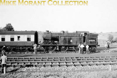 REC: Saracens Head Rail Tour 15/6/57 Gresley N2 class 0-6-2T no. 69594 at the site of the abandoned Watton-at-Stone station which was the northernmost point that this tour reached although the accompanying ticket suggests that it was supposed to continue to Stevenage. One can see from the background that Watton was a desolate spot in those days and a far cry from what it has become.