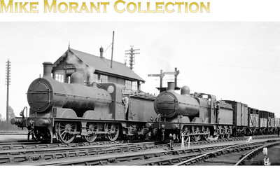 The M&GNJR's small fleet of 0-6-0 tender engines encompasses a number of complexities several of which are visible in this picture which was taken during 1934 at a classic M&GN location, Melton Constable, with the Melton East signal box as the backdrop. There were 0-6-0's of both Midland and Great Nortern origins on the M&GN and both are featured here thereby providing us with a ready comparison of the two designs. On the left is no. 82 which was an Ivatt design akin to the LNER's J4 class but it's been modified at the front end and more resembles a Derby product. No. 82 had been built by Dübs & Co. in October 1900 and survived into LNER days becoming 082 in March 1937 and was further renumbered in 1946 to become 4157 but withdrawal came in August 1947. On the right is no. 68 which was a standard Johnson design for the MR and was built for the M&GN by Kitson in April 1899. No. 68 was less fortunate than its compatriot in this picture because it was withdrawn in November 1936 and not taken into LNER stock.
