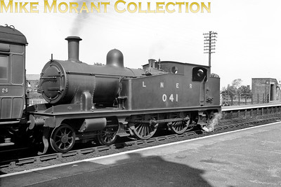 M&GN 4-4-2T no. 41 was a home built product emerging from the company's works at Melton Constable in December 1904 being the first built of the three members of this class some four years before no. 20 entered service. The loco is depicted here rebranded as LNER no. 041 which occurred in September 1937  subsequently becoming LNER class C17 in 1942 and was withdrawn in January 1944. A viewer has informed me that this is probably a service bound for Mundesley and that the picture was taken at the GER's North Walsham station.