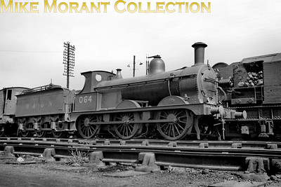 M&GNJR class 'D' 0-6-0 no. 64 was built by Neilson & Co. in September 1896 and acquired the depicted LNER no. 064 before May 1937. Withdrawal came in March 1944 by which time the loco had been reclassified as J40 in the LNER scheme of things. Note that the LNER number has been applied but the tender is still branded with M&GN.
