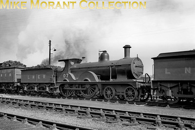 M&GNJR class 'C' 4-4-0 no. 7 was built by Sharp Stewart in August 1894 and acquired the depicted LNER no. 07 in October 1936. Withdrawal came in June 1937. Note the tablet catching apparatus on the tender.
