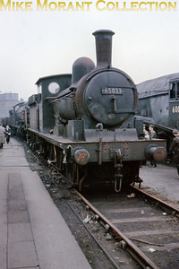 The last NER T. W. Worsdell designed J21 0-6-0 No. 65033 dating from 1889 stands hopefully outside Darlington works on May 2nd 1964 long after her siblings had been scrapped. Preservation followed and she is now cared for by the LCLT (Locomotive Conservation and Learning Trust) whose web site informs us that 65033 hasn't been steamed since 1984.