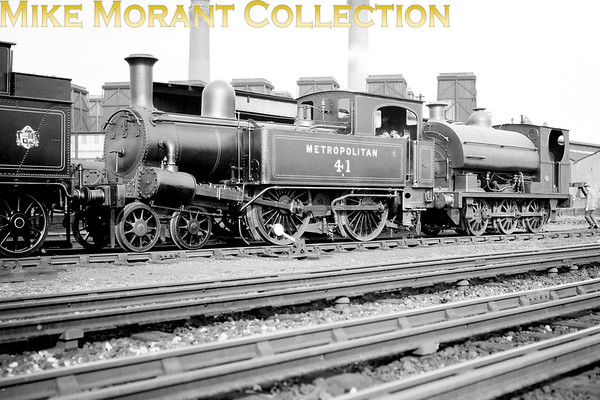 Metropolitan Railway Beyer Peacock 'A' class 4-4-0T no. 41 and 0-6-0ST no. 102 at Neasden on 27/8/1927. No 41 was built in 1869 with works no. 865 and achieved some measure of fame becoming one of the pair of 'A' class tanks that saw out their days on the Brill branch and was withdrawn in 1936.<br>  No. 102 was built by Peckett with works no. 823 in 1899 and would be withdrawn as LT no. L54 Lillie Bridge depot in 1961<br> [<i>Mike Morant collection</i>]