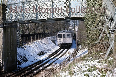 London Underground 'A' (for Amersham) stock in recently fallen snow on what I think was 31/3/75 at Chesham where I lived at that time.