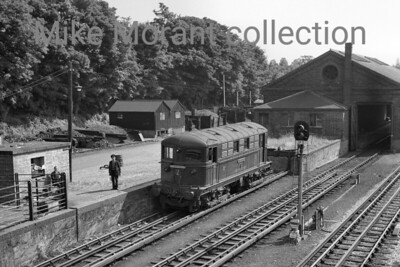 There was a distinctly rural feel to Rickmansworth in the 1950's and here we see London Transport's Metropolitan Vickers Bo-Bo electric loco No. 2 Thomas Lord stabled by the loading dock just to the south of the station in 1958.
