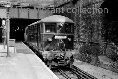 An undated but crisp and detailed shot of London Transport Metropolitan Vickers built Bo-Bo electric loco No. 13 Sir Ralph Verney at Baker Street station.