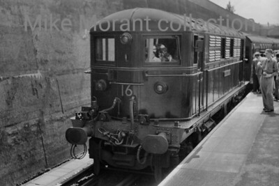 London Transport Metropolitan Vickers Bo-Bo electric loc no. 16 Oliver Goldsmith coupled to the Uxbridge 50th anniversary tour stock at Uxbridge on 4/7/54. LT no. 16 would be withdrawn in 1962 but would be stored until 1966 before scrapping took place. [Mike Morant collection]