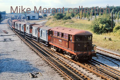 London Transport: 50th Anniversary of the Metropolitan Electric Locmotives 10/9/72 Metropolitan Vickers Bo-Bo electric no. 12 'Sarah Siddons'  leaves southbound from Amersham with the tour's rake of brake vans and ably supported by classmate no. 5 John Hampden bringing up the rear. West Hampstead would be the next reversal in order to ride on the Stanmore branch.