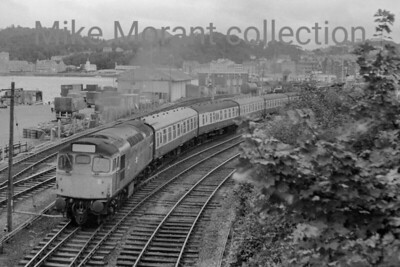 British Railways diesel An unidentified BRCW Sulzer Type 2 class 26 leaves picturesque Oban in August 1978.