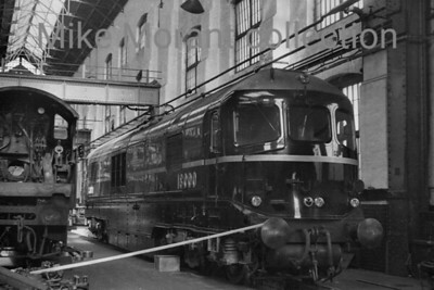 The Western Region's experimental Brown-Boveri A1A + A1A gas turbine no. 18000 inside Swindon Works on 30/4/50. 18000 became know as Kerosene Castle because of the trail of foul smelling fumes left in its wake when in service. [H. C. Casserley / Mike Morant collection]