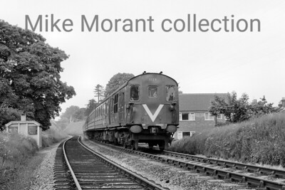 A pair of Hampshire & Berkshire DEMU's  - 1129 leading and 1106 behind -   near Alton on 29/5/64. The 'V' painted on the front of the brake end driving cab indicated to station staff that the luggage van was at this end of the unit. [Mike Morant collection]