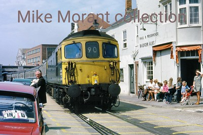 A June 1973 shot of an unspecified Crompton type 3 diesel in charge of a Channel Islands boat train as it negotiates the tortuous route alongside the Harbour and eventually to the Quay station. [Mike Morant collection]