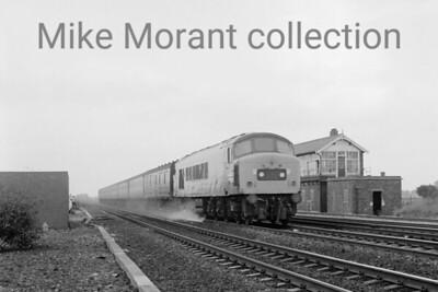 British Railways diesel A Sulzer Type 4 'Peak' class 45 hurtles past Church Fenton signal box.
